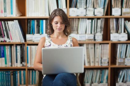 Woman using laptop in library