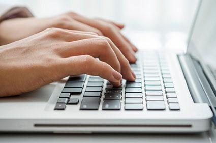 Closeup of typing on computer