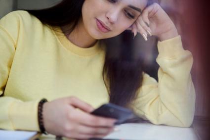 Woman using poem writing app