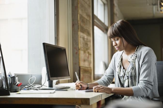 Freelancer working at bright desk space