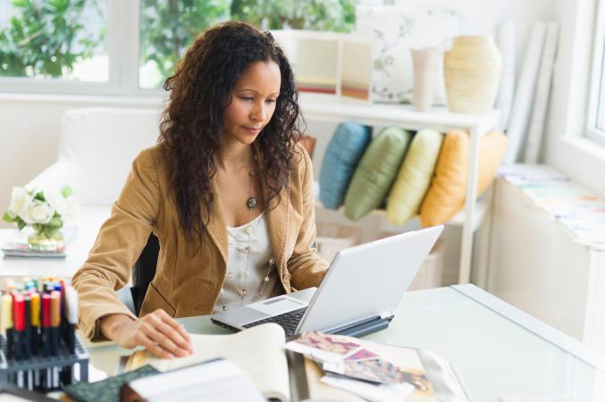 Freelance woman writer on laptop computer