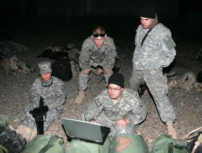 Image of a reporter embedded with soldiers