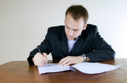 Man in the process of writing a poem
