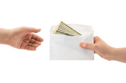 An exchange of a money-filled envelope