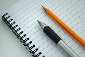 writing pad with pen and pencil