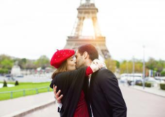 Romantic couple kissing near the Eiffel Tower in Paris