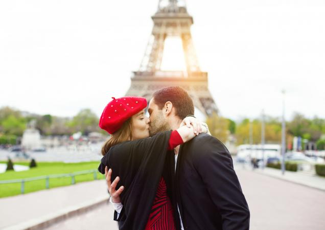 Romantic couple kissing near the Eiffel Tower in Paris