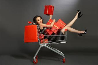 https://cf.ltkcdn.net/fun/images/slide/201832-850x567-Woman-in-shopping-cart-with-gifts.jpg