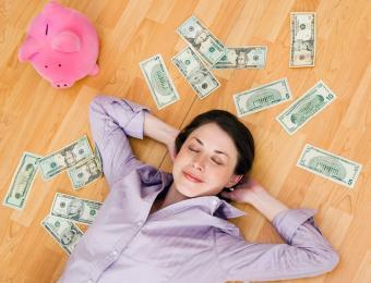https://cf.ltkcdn.net/fun/images/slide/203831-850x649-Woman-with-cash-and-piggy-bank.jpg