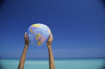 Holding up a globe