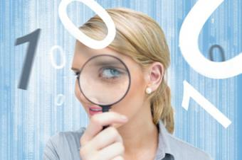 Woman studying numbers with magnifying glass