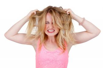 Frustrated woman pulling her own hair