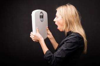 woman looking at scale in shock