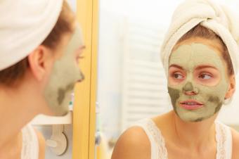 Woman wearing green mud mask
