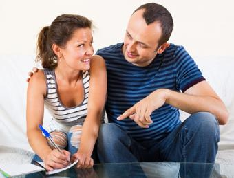 Husband and wife making notes