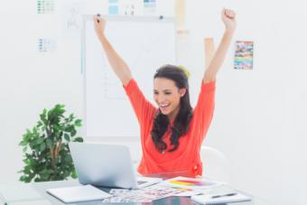 Excited woman raising her arms