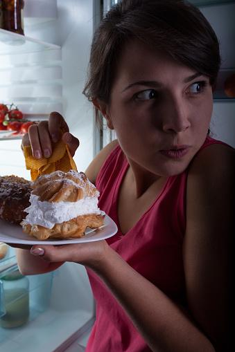Woman eating in secret