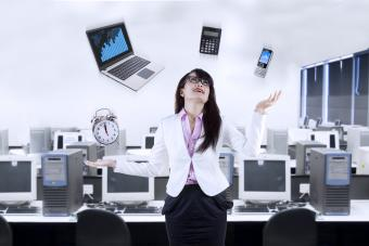 Woman juggling electronic devices