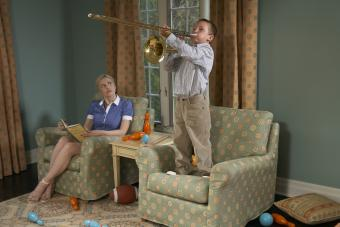 Mother with boy playing trombone