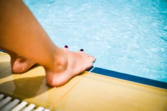 Feet next to pool