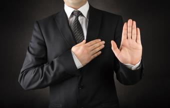 Man in suit taking oath