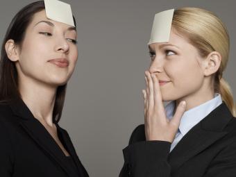 Businesswomen Wearing Blank Notepaper on Foreheads