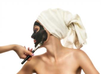 Woman having a mud mask applied