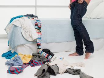 Woman with pile of clothes