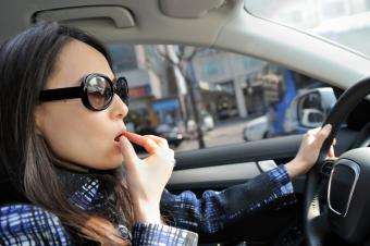 Woman eating while driving to work