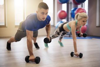 Couple doing push ups with weights