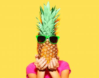 Woman and pineapple with sunglasses