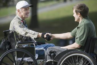 Mature war veteran shaking hands with a young man
