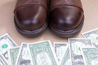 Boots with money on the ground