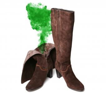 Pair of boots emitting stinky green fumes