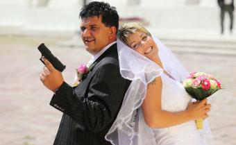 wedding couple with gun