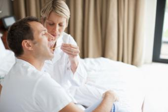 wife taking husbands temperature