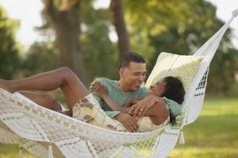 couple hugging in hammock