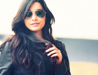 Woman wearing leather jacket & sunglasses