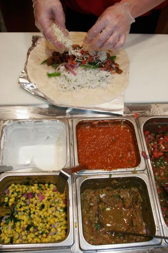 Chipotle restaurant burrito being made