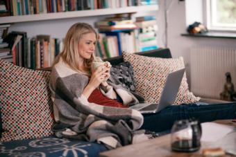 Woman watching a movie in a laptop