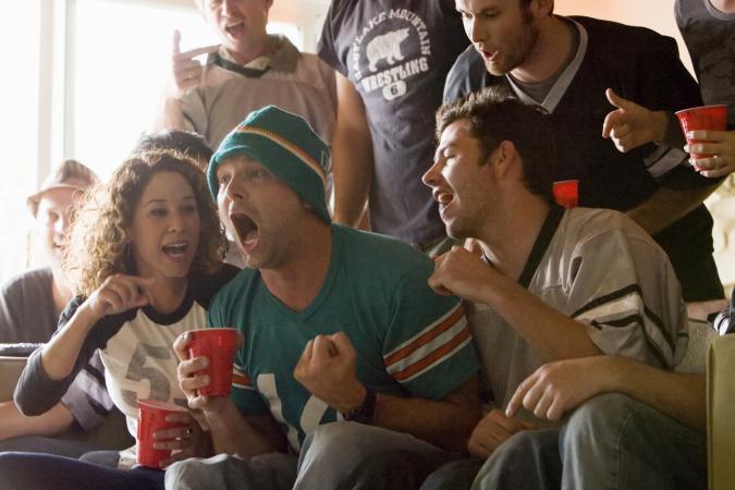 friends watching football
