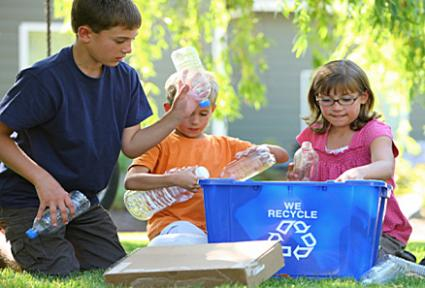 Father and daughter filling recycle bin