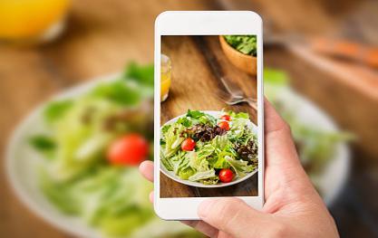 Taking photo of salad