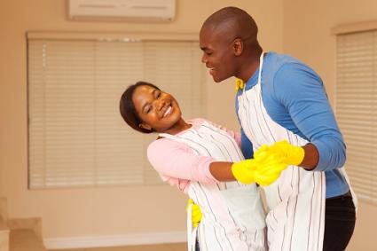 Couple dancing while cleaning