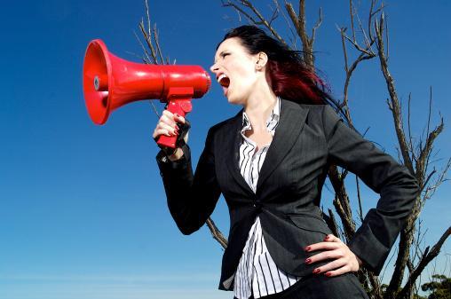 Woman yelling into a mega phone