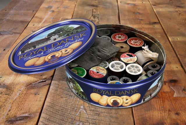 Blue tin with sewing kit
