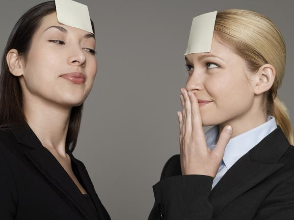 Businesswomen Wearing Blank Notepaper on Foreheads