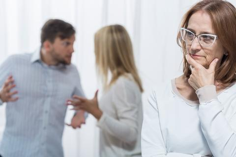 Woman listening to family conflict