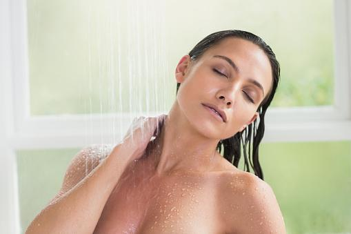 Brunette taking a shower