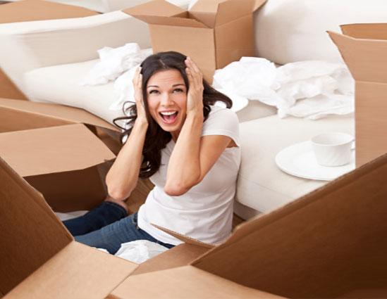 Frustrated woman unpacking boxes and screaming